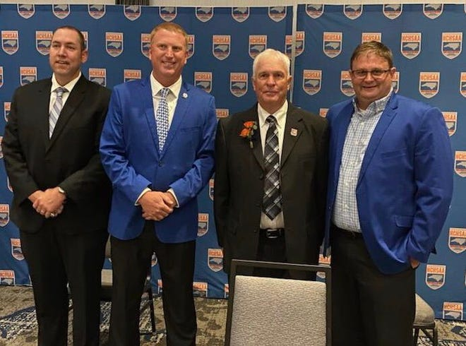 Henry Jones (second from right) is pictured during Saturday's NCHSAA Hall of Fame ceremonies with (left to right) Cherryville assistant baseball coach Brian Kiser, athletic director Scott Harrill and baseball coach Scott Heavner.