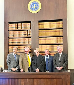 Shown at a recent swearing-in ceremony for Whitney Brown at Gardner District Court are past and current presiding justices, from left, Honorable Mark Goldstein, Honorable Timothy Hillman, Brown, Honorable Arthur Haley and Honorable Patrick Fox.