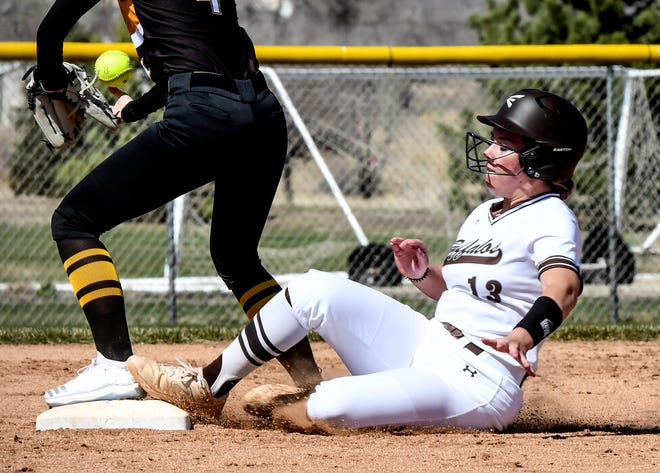 Garden City High School's Rilee McGraw slides safely into second base for a double against Goodland during a game earlier this season at Tangeman Sports Complex.