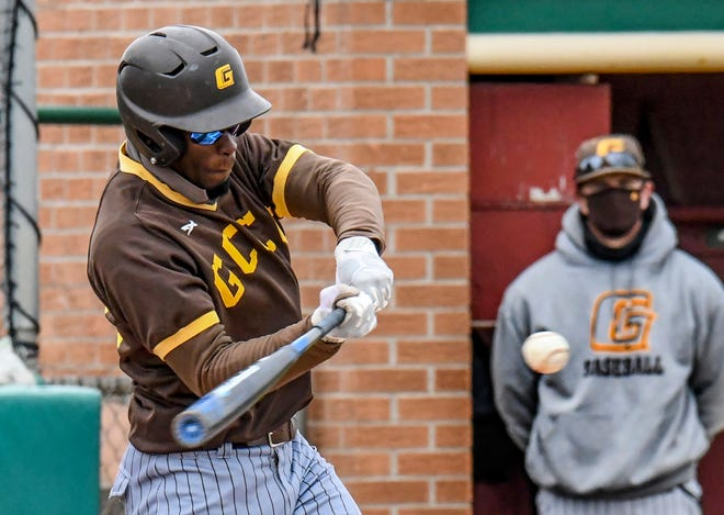 Garden City Community College's Michael Wright connects with a Colby pitch for a two-run single April 17 at Williams Stadium.