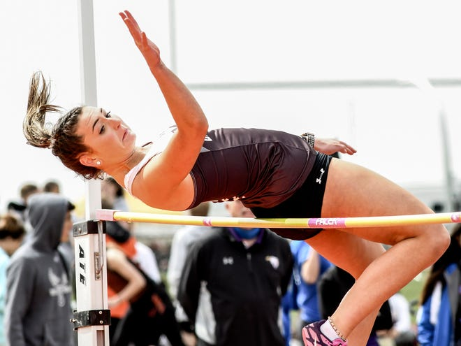 Garden City High School's Julie Calzonetti clears the bar at 4-6 on her way to winning the girls' high jump competition at 4-9 Friday at the Holcomb Invitational.