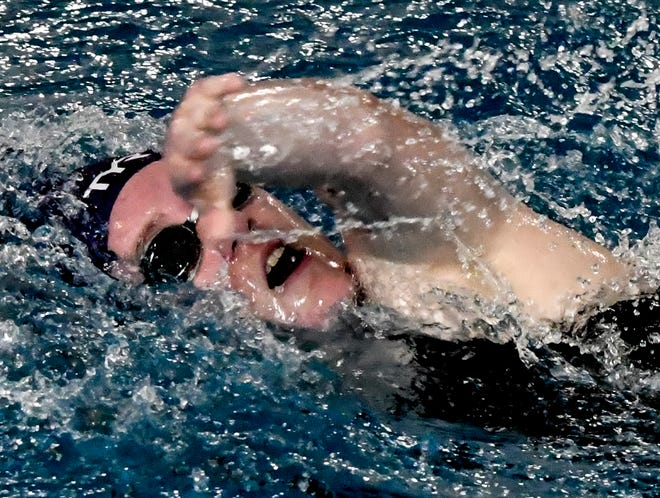 Garden City High School's Paige Chappel reaches forward to make a stroke in a 200-yard freestyle race April 13 on a home swim meet at the Garden City Family YMCA.  Chappel won two individual event titles Friday at Marion.
