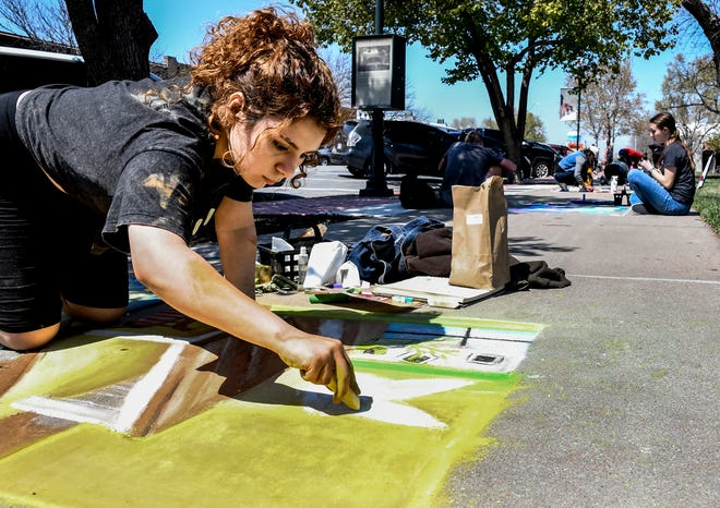 Glenda Trevino works on her chalk drawing Saturday on a sidewalk square at Stevens Park during Garden City Arts sidewalk chalk contest.  Trevino was among 62 artists, of all ages from amatuers to professional artists, to participate in the event.