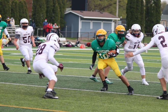 Jackson Reade (No. 10) carries the ball in the Geneseo freshman-sophomore football game that ended with a victory for Geneseo over Moline, 35-14, on Friday, April 23, at Bob Reade Football Field in Geneseo.
