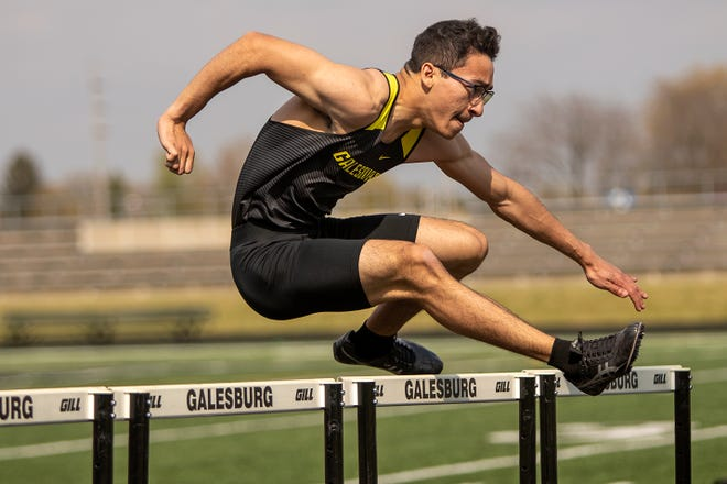 Galesburg High School senior Alexander Harvey competes in the 110m high hurdles during the Silver Streaks' boys and girls triangular meet with Quincy and Metamora on Saturday, April 24, 2021 at Van Dyke Field.