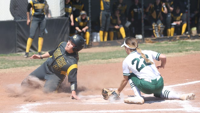 FHSU's Loren Beggs slides home safely during the second game of Saturday's  doubleheader with Northeastern State at Tiger Stadium.