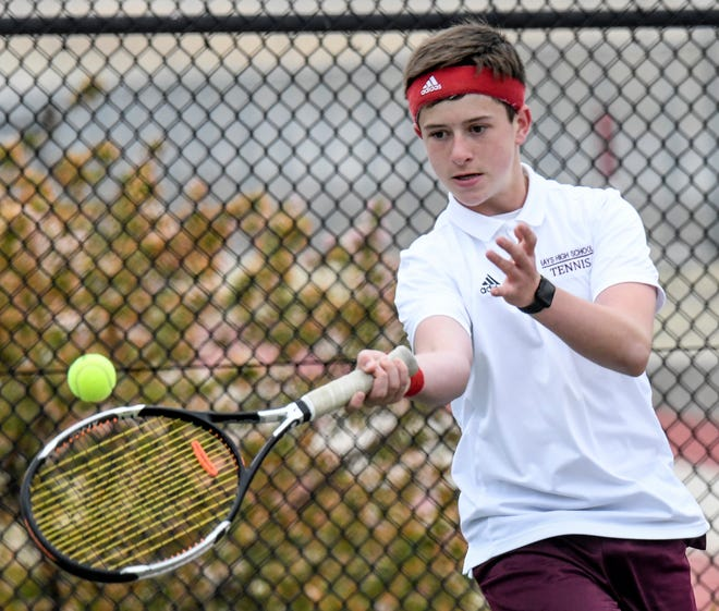 Hays High School's Colin Clark hits a forehand shot down the line Saturday during a singles match in the Garden City High School boys tennis invitational. Hays tied for second place as a team with Great Bend.  Garden City won the tournament.