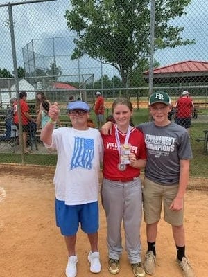 Carl Holbert, left, celebrates with Carrigan Holbert, the granddaughter of Jeff and Sarah Holbert, at the 2019 SC Little League state championships. At right is Jordan Holbert.