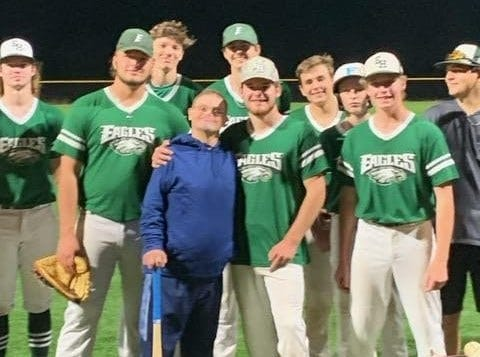 East Henderson High's baseball team poses with Carl Holbert (cemter) after a game two years ago.