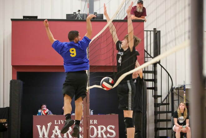 Jacksonville Christian Academy and Living Water Christian School recently played a boys' volleyball match.  [Tina Brooks / The Daily News]