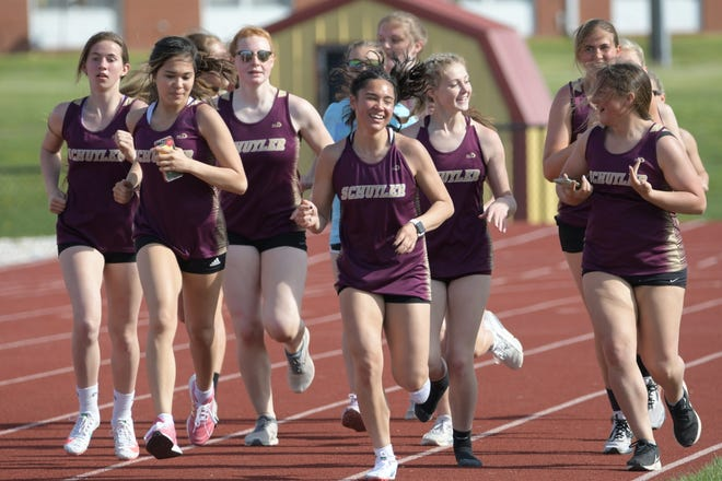 The Schuyler County girls track team celebrates winning Monday's Rachel Morris Relays by running a victory lap.