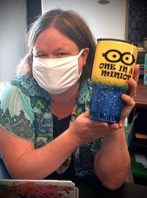 Bok North Academy teacher Natalie Cole shows off one of her favorite teacher appreciation gifts, an Arctic hot/cold insulated drink mug, decorated with her favorite animated character, a minion.  [Provided Photo]