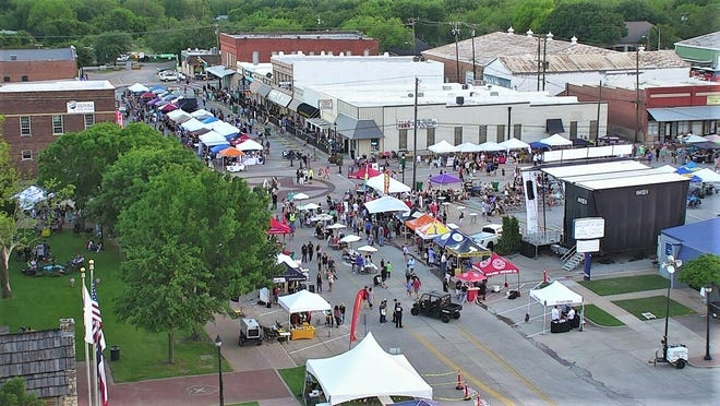 Historic downtown Midlothian is filled with vendors and patrons during a recent Spring Wine and Arts Festival. The festival, organized by the Midlothian Chamber of Commerce, returns to downtown this Saturday.