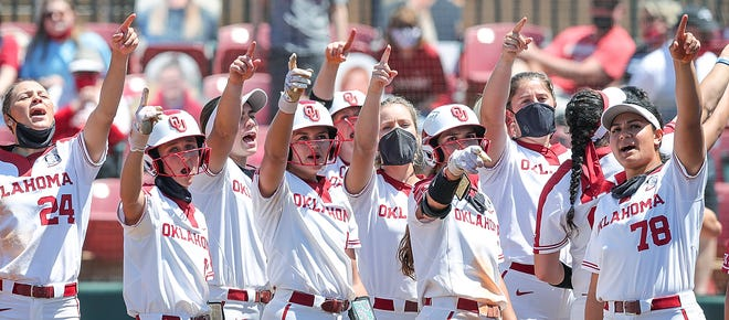 The Oklahoma softball team points to the crowd following a 20-0 run-rule win over Texas Tech on Sunday. Oklahoma's Saturday matchup against Oklahoma State at 3 p.m. has been picked up by ESPN. [Ty Russell/OU Athletics]