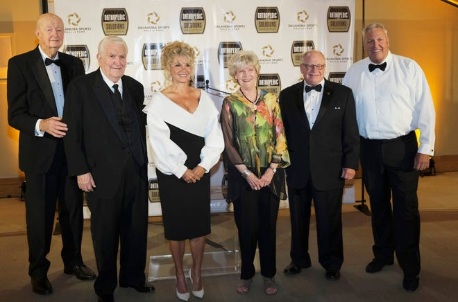 """From left: Hubert F. """"Hub"""" Reed, Lee Allan Smith, Sherri Coale, Shirley Chesbro for husband, Tommy Chesbro, Eddie Griffin and Rob Ryan accepting for his father James David """"Buddy"""" Ryan  at the Oklahoma Sports Hall of Fame induction ceremony Monday, April 26, 2021. Also inducted but not present Stacey King."""