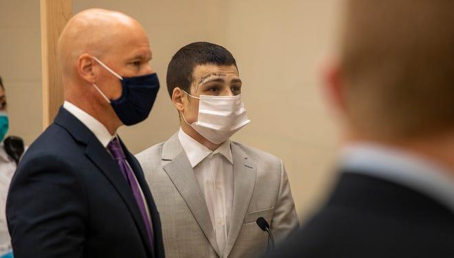 Tyler MacLean, center, is accused of stabbing three men in Quincy.
