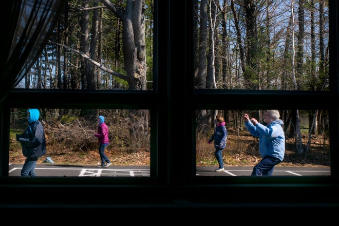 Residents participate in a line dancing class at the Center for Active Living in York, Maine, on Friday, April 23, 2021.