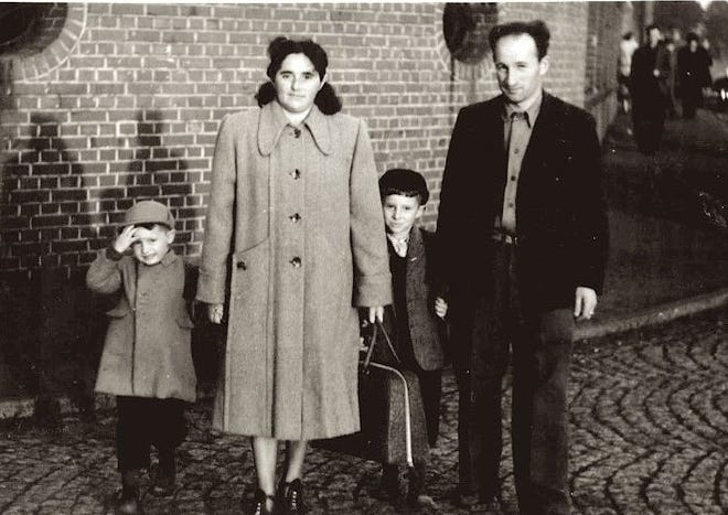 The Feldman family prepares to leave Europe for the United States after the Second World War. From left: Irving, mother Frieda, father Mendel and older son Fred, who lives in Kensington and has penned a memoir.