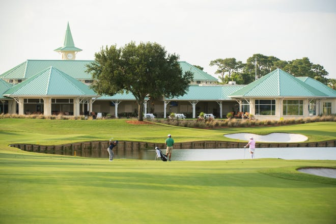 Golfers competing in the PGA Professional Championship play the 18th hole at PGA Golf Club in Port St. Lucie on Sunday.