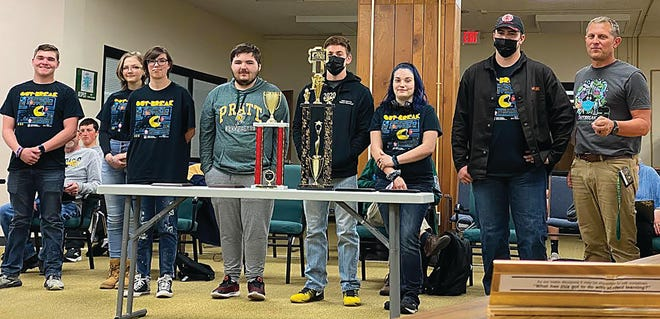 Pratt High School 2021 robotics team members (from left) Andrew VanSlyke (jr), Celeste Edwards, Nick Vail (sr), Hogan Thompson (sr), Justice Fanning (jr), Derrick Newby (sr), Heath Sharp (advisor) brought their club trophy from a recent virtual competition to the April USD 382 BOE meeting to show board members.