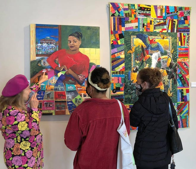 Artist Catherine Venable describes her 'The Page Turner' painting to visitors at Petersburg Area Art League on April 17, 2021.