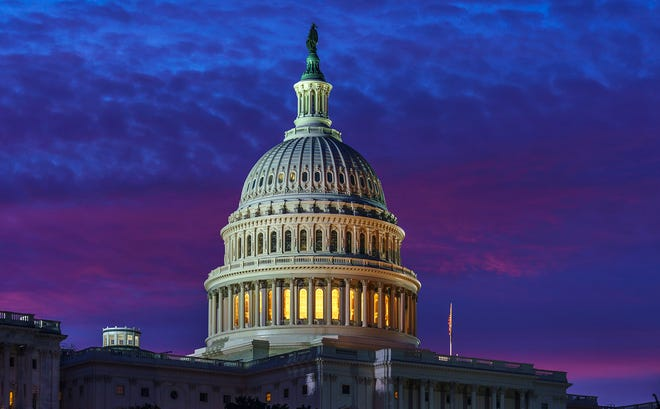 Dawn breaks over the U.S. Capitol on Nov. 6, 2020. With every Census comes a rebalancing of seats in the 435-member House of Representatives. Rhode Island, having retained both of its seats, will be spared a potential battle between the state's two incumbent Democratic congressmen, Representatives Jim Langevin and David Cicilline, for what would havebeen one at-large seat after next year's election.