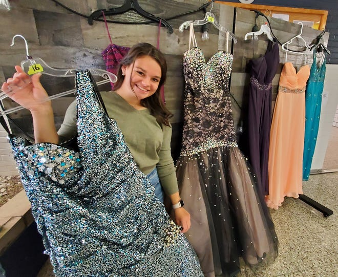 Fairless High School senior Annabelle Ehmer shows off some of the prom gowns available for Stark County students.