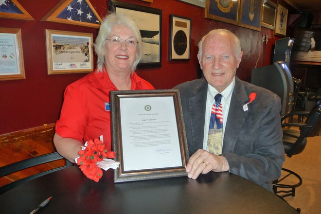Linda Henderson, Story City's American Legion Auxiliary president, Mayor Mike Jensen kick off Poppy Month in Story City.