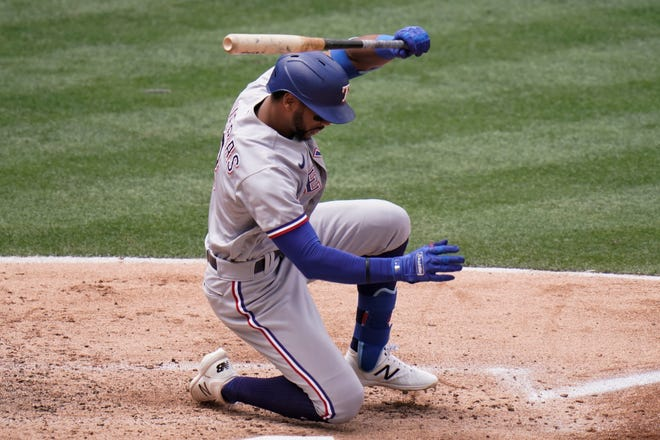 Texas Rangers' Leody Taveras loses his balance after swinging at a pitch during the third inning of a baseball game against the Los Angeles Angels, April 21 in Anaheim, Calif.