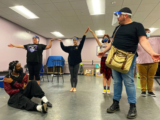 "Cast members rehearse for the Dingbat Theatre Project production of ""Shrek the Musical,"" which will be presented outdoors with a cast of eight."