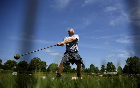 Chris Nickell hurls a 16-pound hammer during the athletic portion of the Springfield Area Highland Games and Celtic Festival in Chatham Community Park Saturday, July 23, 2016.