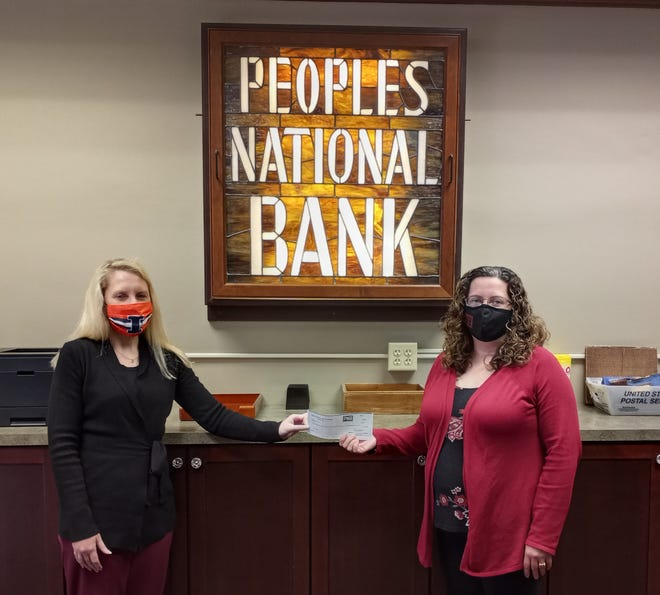 Jennifer Peterson (left), Extension educator for Henry County 4-H Youth Development, accepts a $100 donation from Peoples National Bank employee Michelle DeRycke, who recently walked over 137,000 steps in one week to win the final round of the PNB Wellness Program Challenge: Health Madness Tournament. Michelle chose Henry County 4-H a the recipient for the charity portion of her prize.