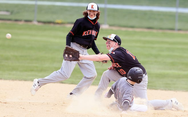Devin Hamrick and Kyle McAdam (10) cover a slide into second base during a Kewanee junior varsity game on Saturday.