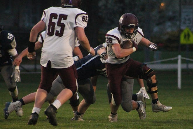 Princeville running back Hunter Boland (26) shrugs off a tackle. He was difficult to bring down all evening, gaining 181 yards on 28 carries.