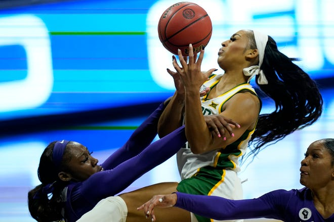 Baylor guard DiJonai Carrington, middle, is fouled by TCU defender Aahliyah Jackson, left, during this year's Big 12  tournament in Kansas City, Mo. Carrington was drafted by the WNBA's Connecticut Sun.