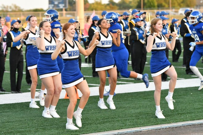 The Washburn Rural cheer squad perform on the sidelines of a football game last year.