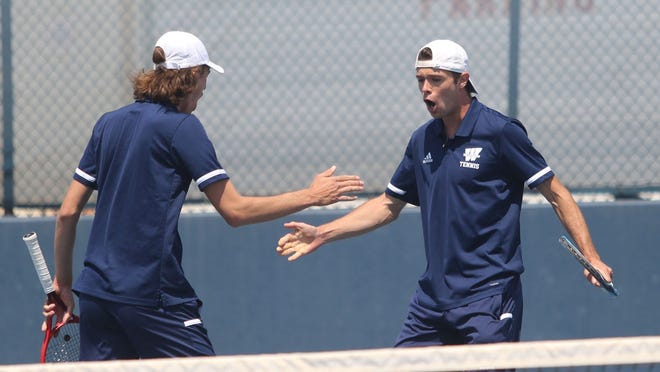 Washburn's Bradley Eidenmueller and Sebastian Pjontek celebrate a point in Saturday's win over Northwest Missouri. The victory earned the Ichabod men the No. 1 MIAA seed at this weekend's MIAA-GAC Championships in Oklahoma.