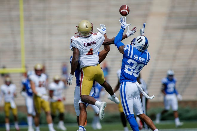 Former Duke cornerback Mark Gilbert (28) intercepts a pass intended for Boston College wide receiver Zay Flowers (4) in the first half of a Sept. 19, 2020, game at Wallace Wade Stadium in Durham.