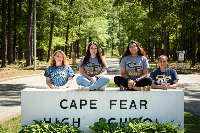 """Sandra Darling, left, Jennifer Barefoot, Araceli Garcia and Jessica Castillo are putting on a """"Spring Fling"""" for Cape Fear High School juniors and seniors after many were excluded from another dance."""
