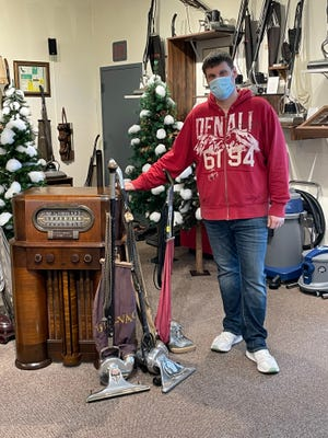John Cadle shows off his collection of sweepers.