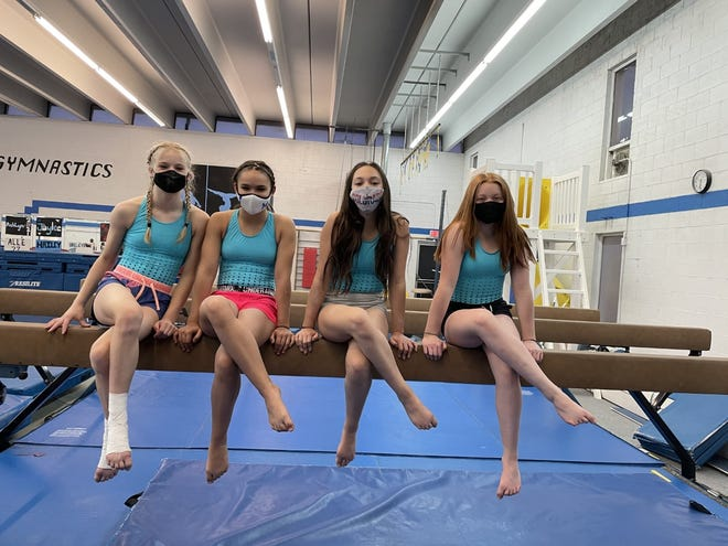 The Nogare's Gymnastics Academy platinum team includes (left to right) Lily Nibert, Karlee Jo Knabenshue, Angelina Capritta, Autumn Zumpf. [Courtesy photo/Kelsey Downs]