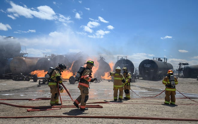 Firefighters from multiple states roll out hoses to battle fires on a mock train derailment at the Transportation Technology Center in 2019. TTCI will move from its current location to Pueblo Memorial Airport Industrial Park thanks to a $4.2 million incentive package negotiated with the help of the City of Pueblo, Pueblo County and PEDCO.