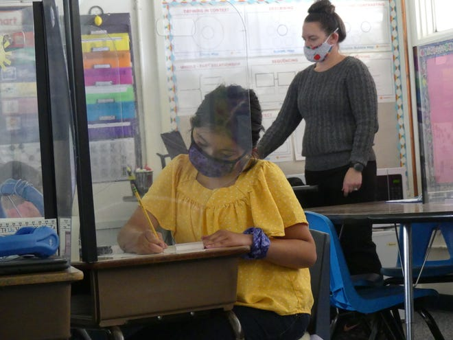 Juniper Elementary School second grade teacher Jessica Phillips on Monday, April 26, 2021, the first day of Hesperia Unified School District's return to full-time on-campus learning for its elementary students.