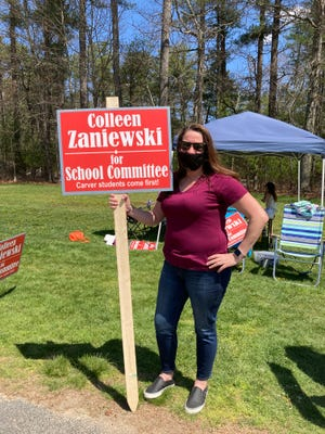 New School Committee member Colleen Zaniewski greets voters outside the polls Saturday.