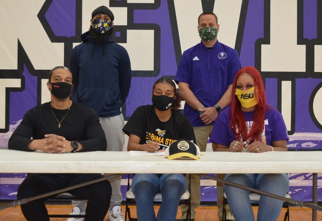 Lakeview's Brazyll Watkins is joined by family and head coach Blake Shaw as she signs her National Letter of Intent to play college basketball at Alabama State University.
