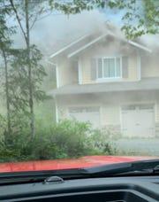 Smoke billows out of a North Kitsap home on Monday.