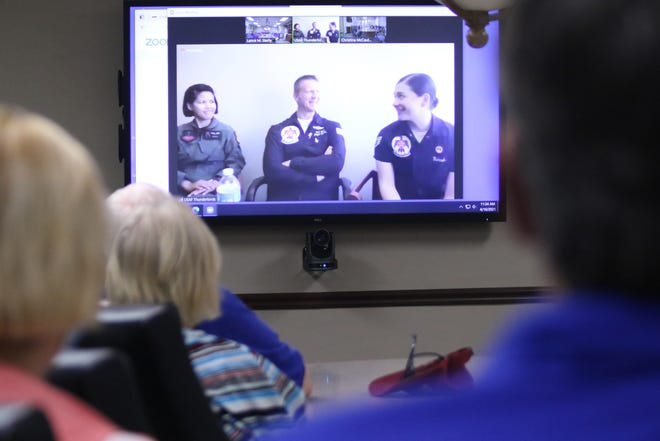 From left, Flight Physician Maj. Mary Eisma, Flight Surgeon Lt. Col. Noel Colls, and Staff Sgt. Laurel Richards answer questions from Health First hospital volunteers during a live Zoom meet and greet opportunity in advance of this year's Cocoa Beach Air Show.