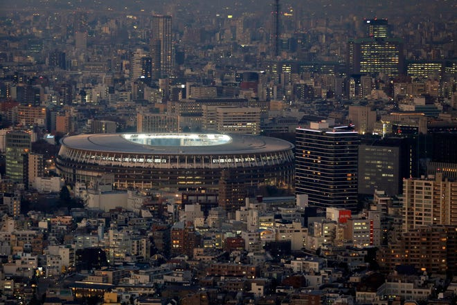 Japan National Stadium, where the opening ceremony and many other events are planned for the postponed Tokyo 2020 Olympics, is seen from a rooftop observation deck on Jan. 21, 2021, in Tokyo.