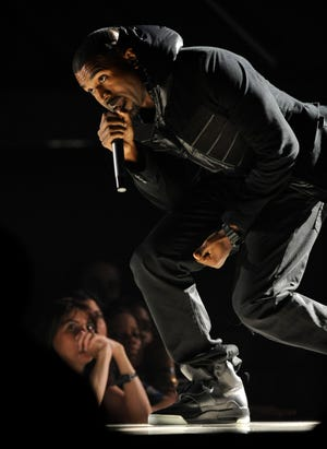 Kanye West performs at the 50th Annual Grammy Awards in Los Angeles on  Feb. 10, 2008. The Nike Air Yeezy 1 Prototypes worn by West during his performance were acquired for $1.8 million by social investing platform Rares.
