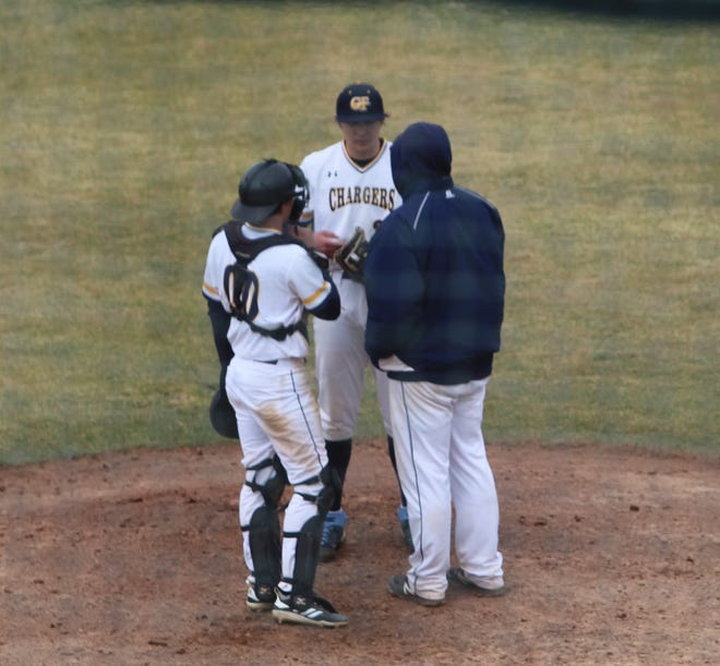 From left to right, Great Falls Chargers AA catcher Keeton Clark, pitcher Josey Hinderager and pitching coach Tanner Watson discuss strategy on the hill late in the second game of a doubleheader against Belgrade Sunday at Centene Stadium.
